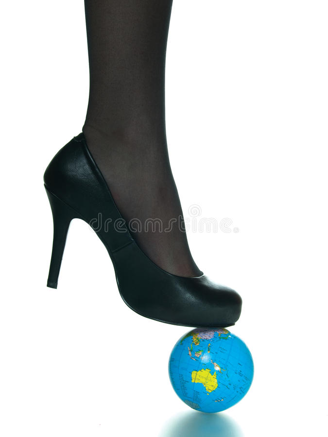 girl foot on top of planet earth globe stock photo