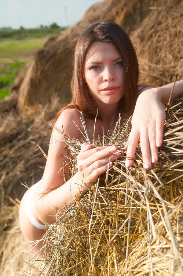 Download Girl On Hay Stack Royalty Free Stock Photography - Image: 32964397