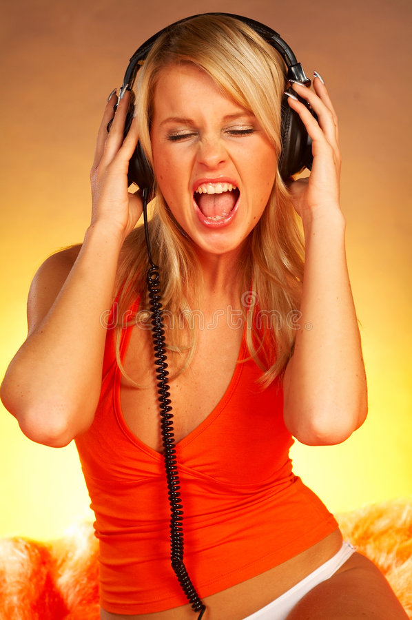 Girl with headphones. Close up stock photos