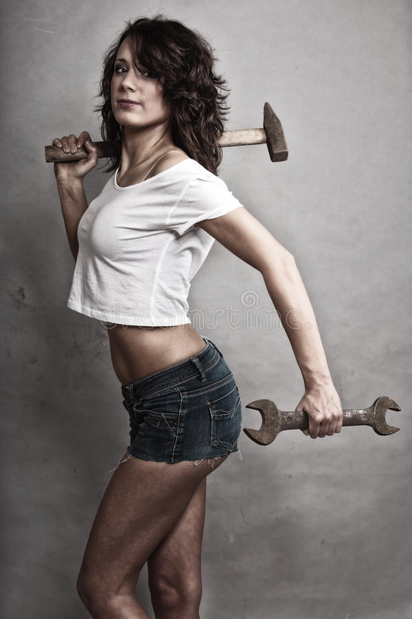 Girl Holding Hammer And Wrench Spanner Stock Photo