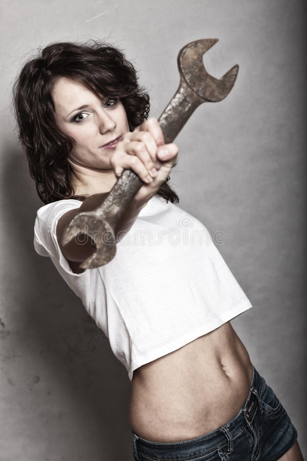 girl holding wrench spanner tool royalty free stock image