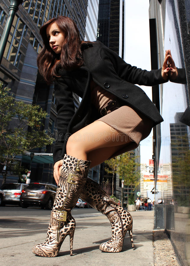 girl in leopard boots royalty free stock image