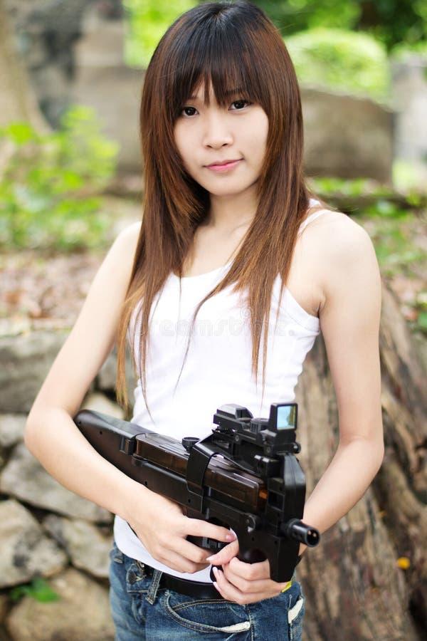 Download Girl with machine gun stock photo. Image of warrior, asian - 26496220