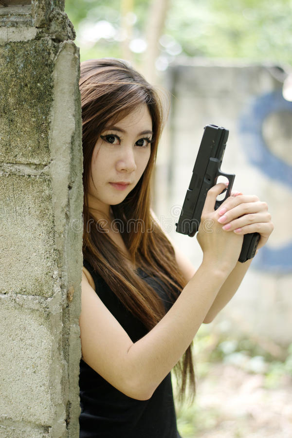 Download Girl with pistol stock photo. Image of magnificent, machine - 26496842