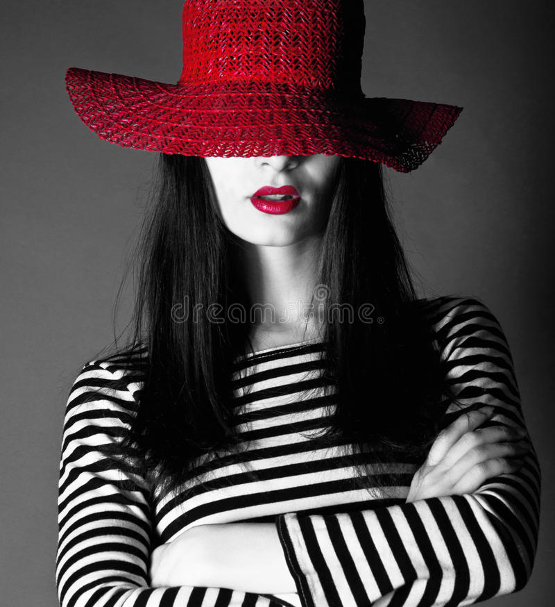 Sexy girl in a red hat with red lips