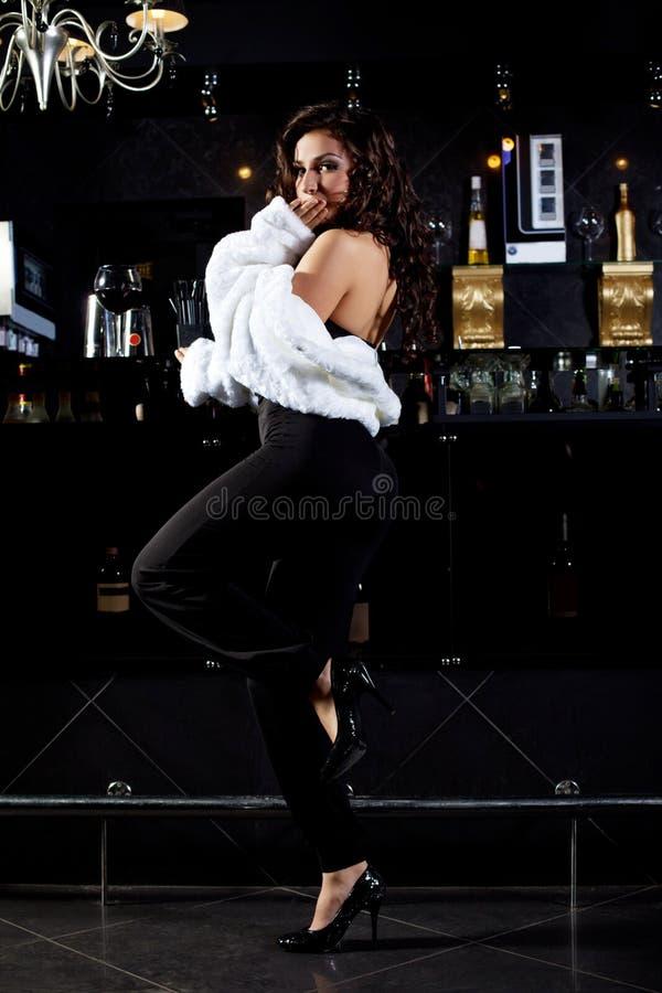 Girl In Retro Fur Coat Stand Near Bar Royalty Free Stock Photo