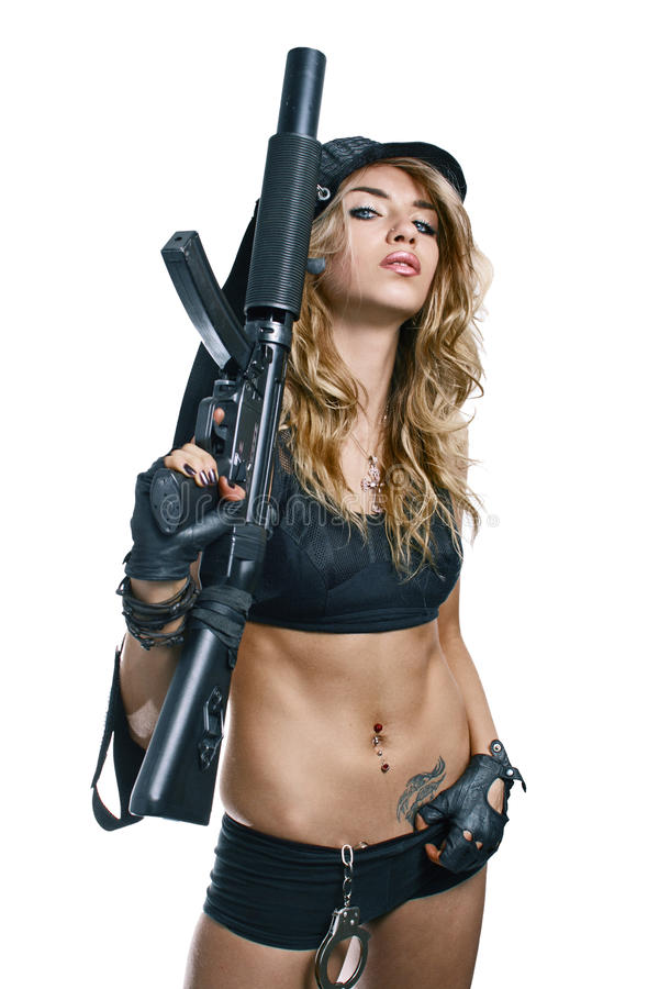girl with a rifle and handcuffs royalty free stock photo