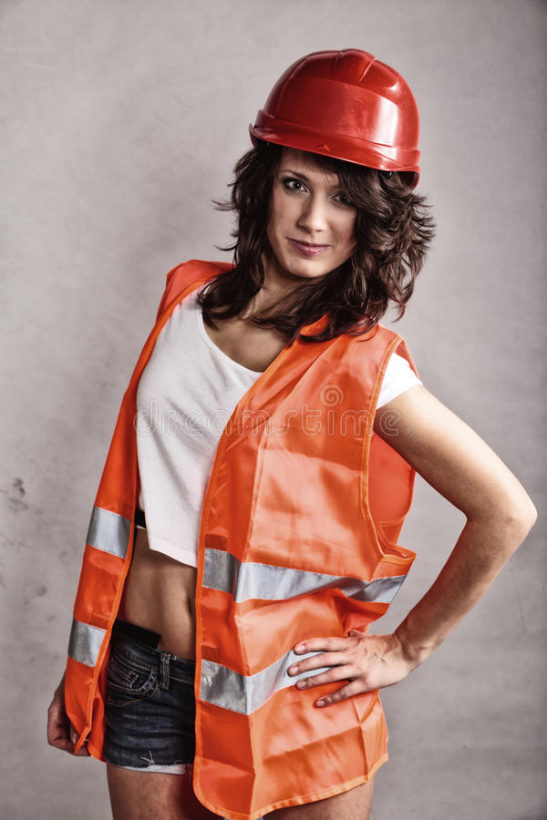 girl in safety helmet and orange vest royalty free stock photo