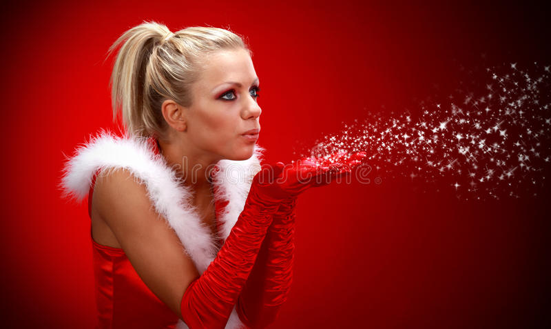 Download Girl In Santa Cloth Blowing Snow From Hands. Stock Photo - Image: 11391382
