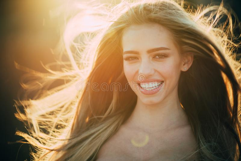 Sexy girl. Sensual woman. makeup and hair style. trendy look. Beauty and fashion. long healthy hair. happy woman with stock image