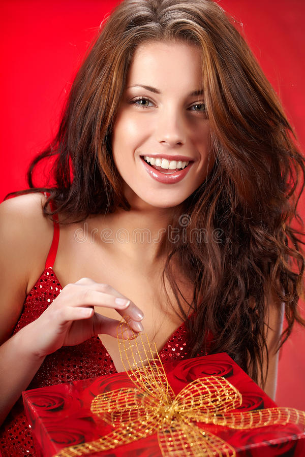 Girl Smiles And Holding A  Gift In Box Stock Photo