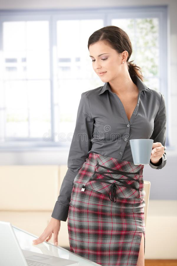 Download Girl Standing By Table Drinking Tea Stock Image - Image of cosy, holding: 17740935