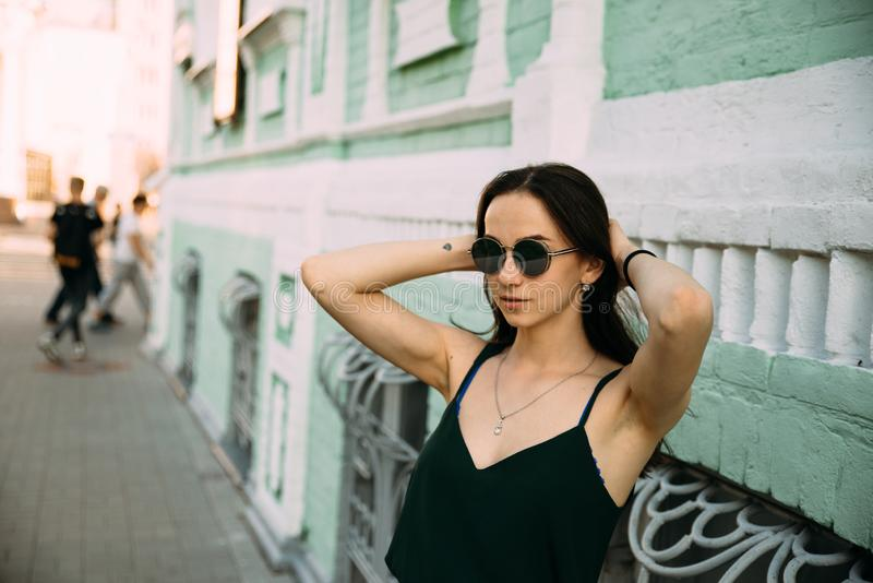 Sexy girl in a T-shirt and short shorts near the building.  royalty free stock photo