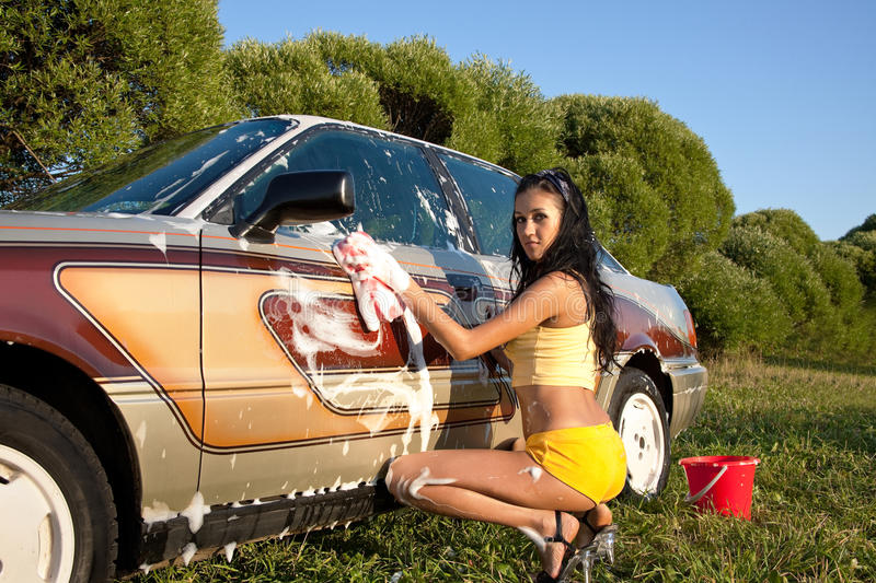 girl washing a car - pin-up style royalty free stock photo