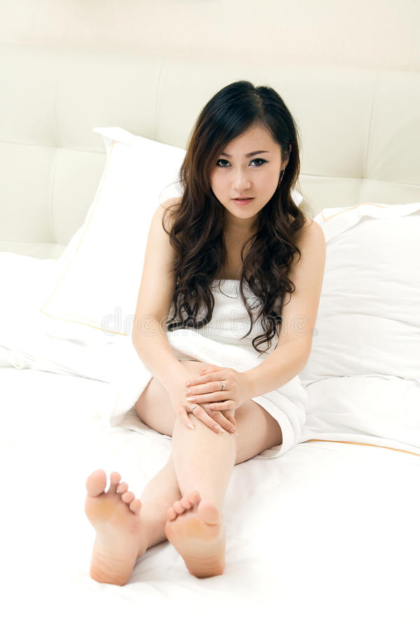girl wrapped in bath towel in bed royalty free stock image