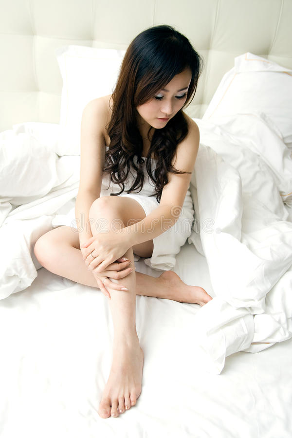 girl wrapped in bath towel in bed royalty free stock photography