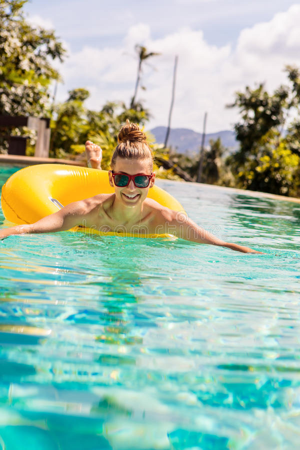 girl with yellow ring at pool party stock image