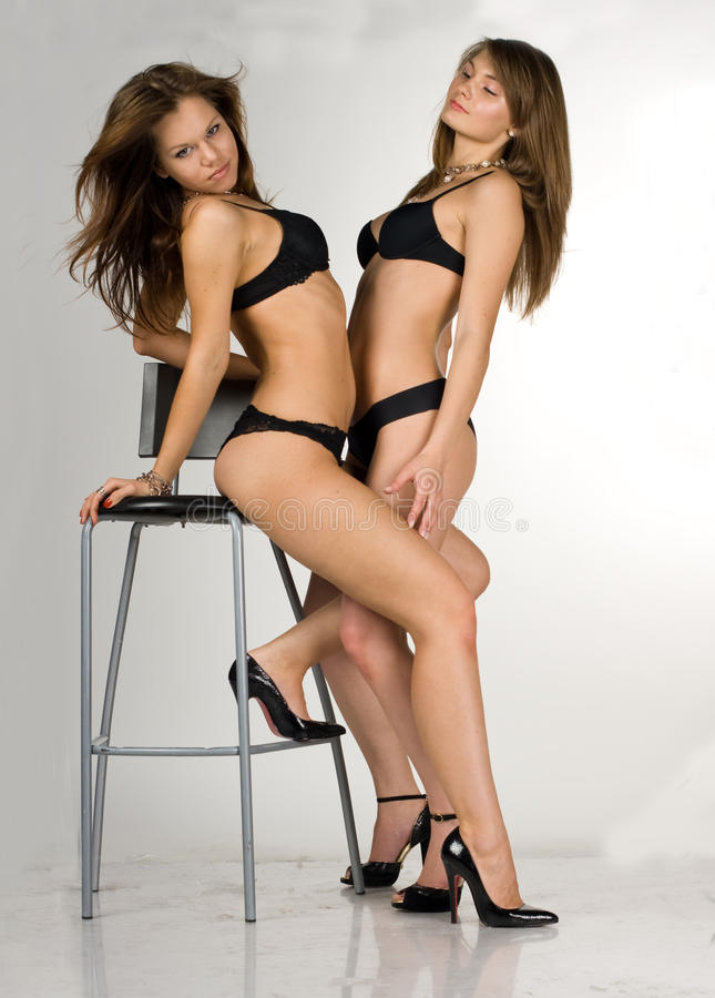 Download Girls In A Black Swimsuit. One Girl Is Sittin Stock Photo - Image: 17203150