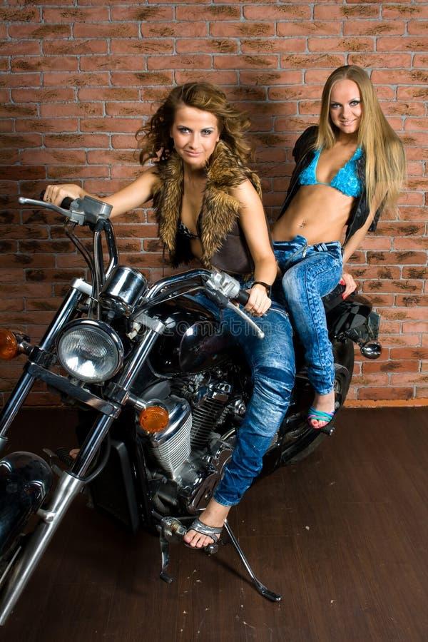 girls on motorbike stock images