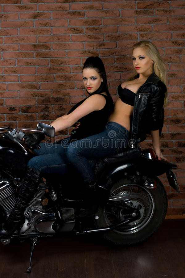 girls on motorbike stock photo