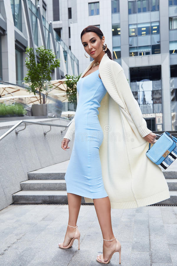 glamour businesswoman walk buildings and trees street stock photos