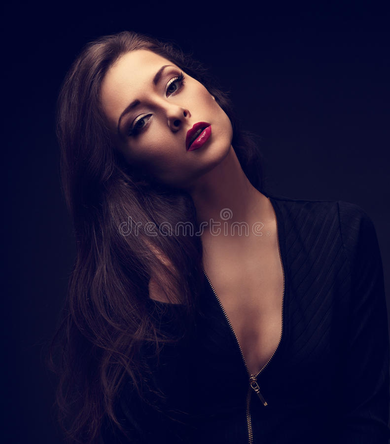 glamour makeup woman with red lips in jacket posing on blac stock photography