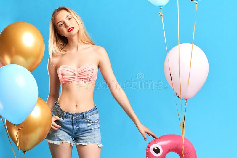 Sexy glamour woman wants to swim in the sea stock photo