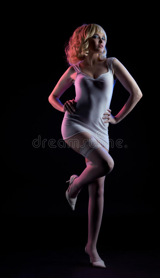 Gold blond woman posing white fashion cloth. Blond woman in white fashion dress - holli would cosplay character royalty free stock photography