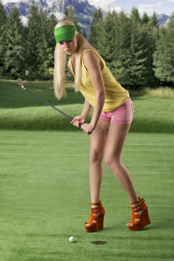 Download Golf Player Woman, She Is Hitting Golf Ball Stock Photo - Image: 25573558