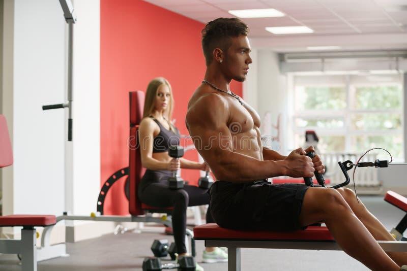 Athlete Muscular Bodybuilder Posing In The Gym Stock Photo