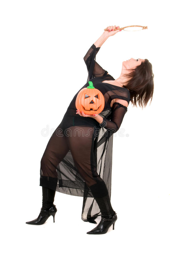 Halloween Witch With Pumpkin And Mirror Royalty Free Stock Photo