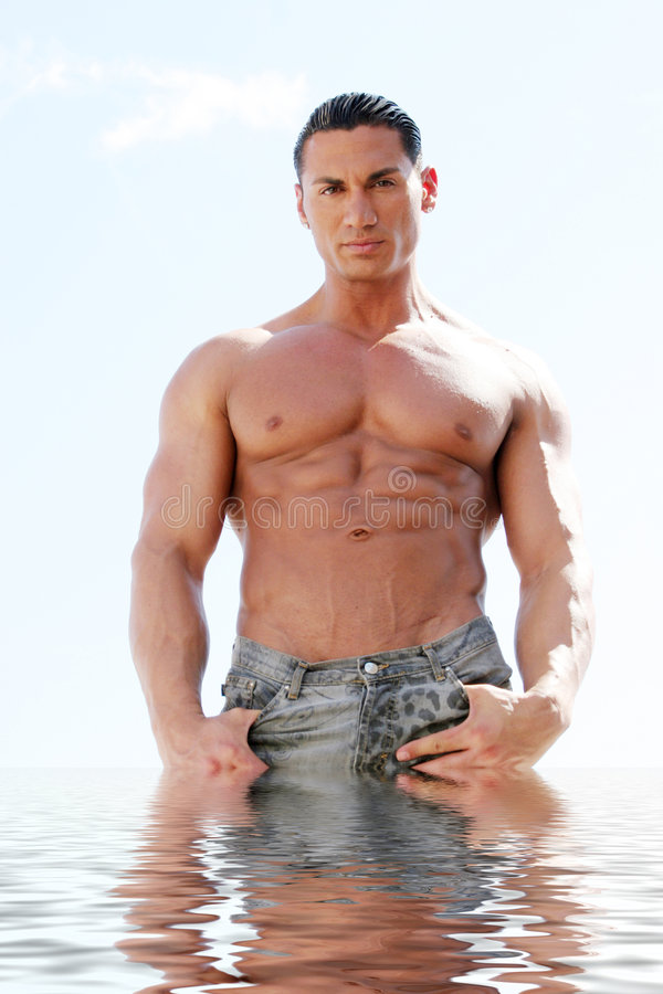 handsome athletic man in water stock images