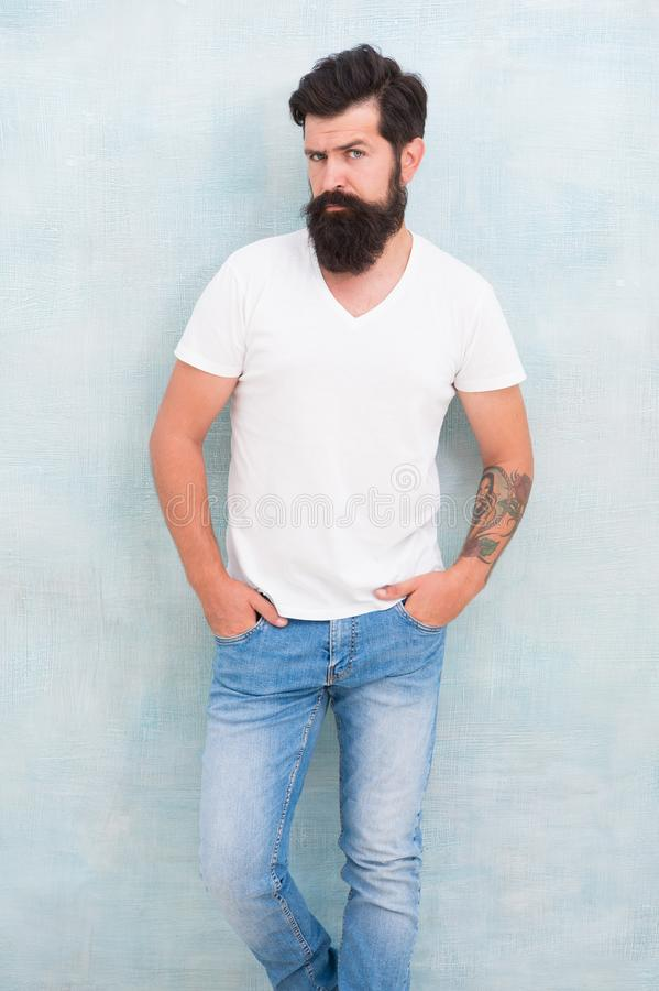 Sexy handsome. handsome hipster jeans. male fashion trends. Simple and casual summer. Brutal macho gray background. Male royalty free stock images