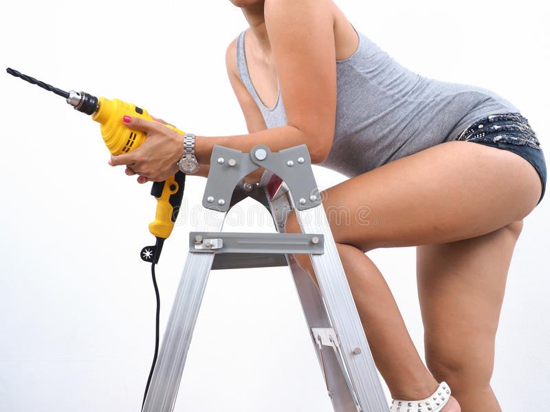 handywoman with electric drill stock photography
