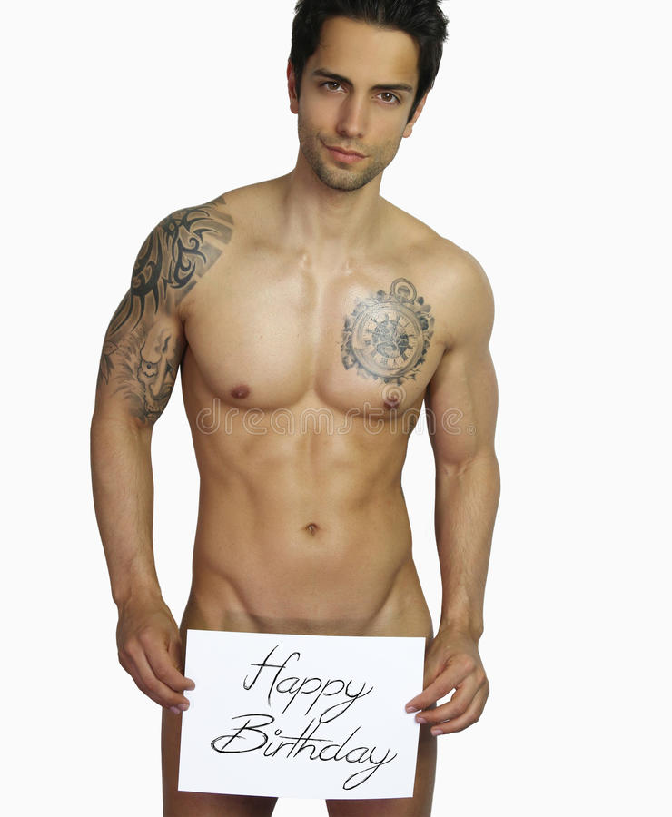 Happy birthday - handsome man naked. Naked young man holding a Happy Birthday sign over a white background royalty free stock photography