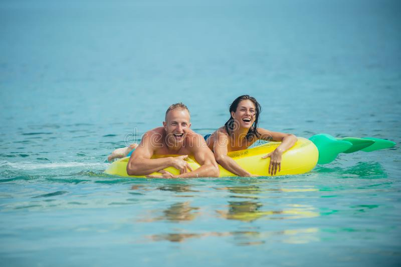 Sexy happy couple on Caribbean sea. sexy happy couple on summer vacation. royalty free stock images