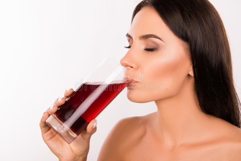 Sexy healthy young woman drinking cherry juice stock images