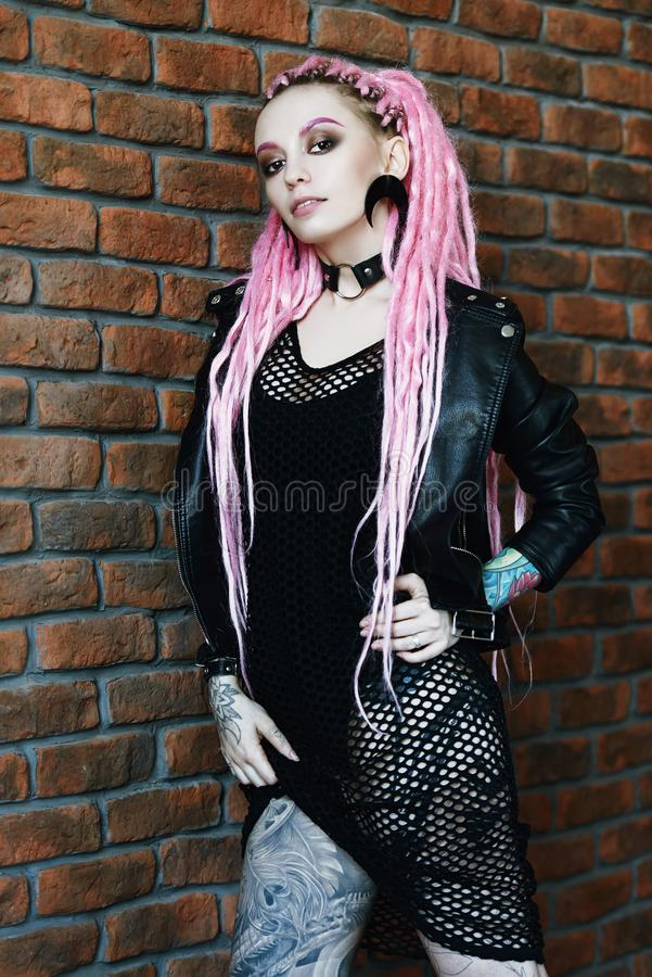 Hipster girl in jacket stock photo