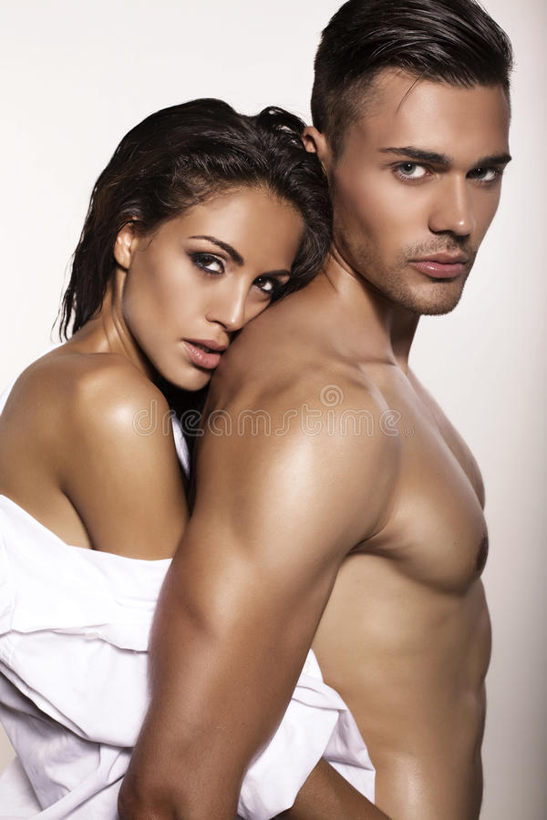 Impassioned couple posing in studio. Fashion photo of impassioned couple posing in studio
