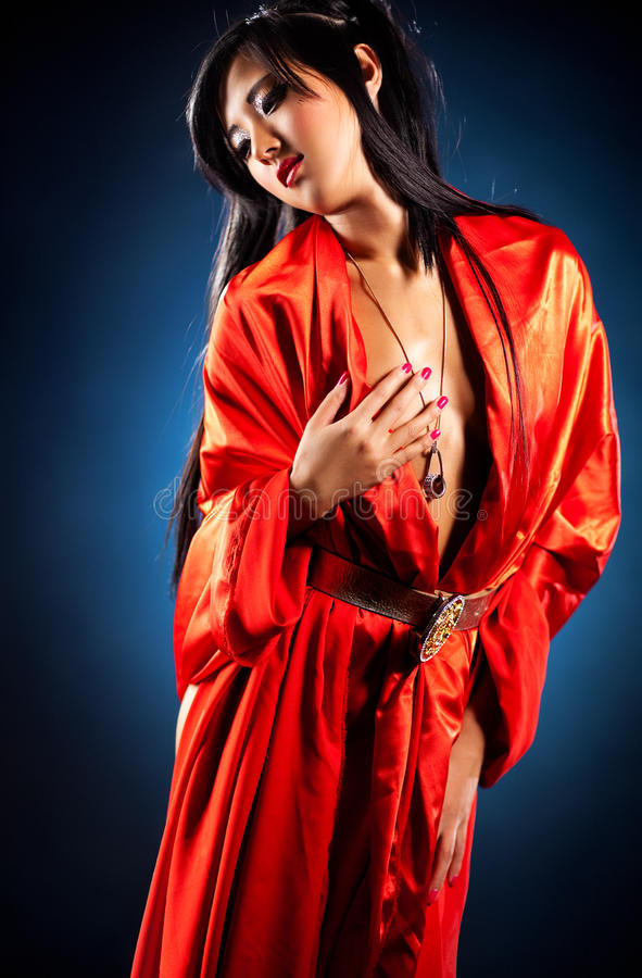 Japanese woman. On red kimono royalty free stock images