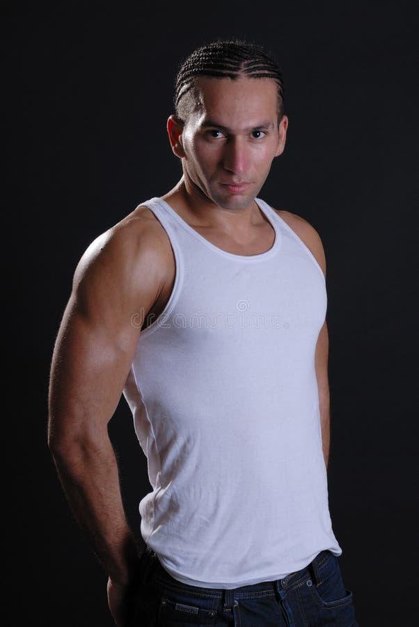 Sexy jong mannetje in witte vestbovenkant royalty-vrije stock foto