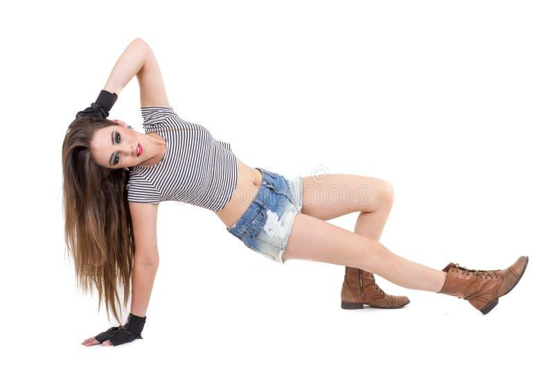 Sexy jong meisje dat denimborrels het stellen draagt stock foto's