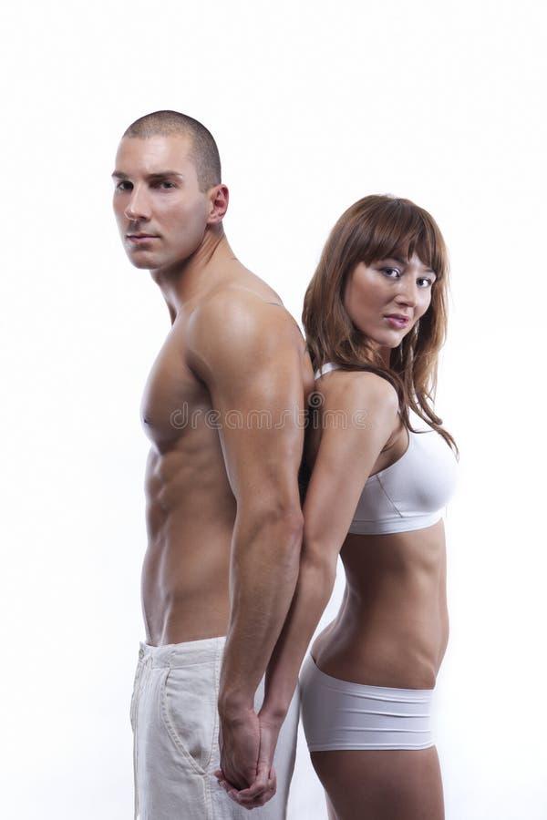 Sexy jong paar in wit stock foto's