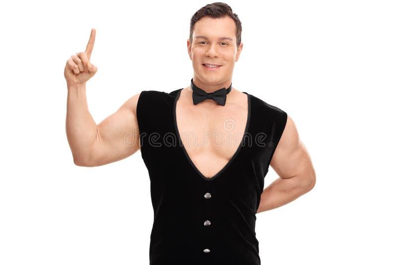 Sexy jonge kerel in een zwarte vest en een vlinderdas royalty-vrije stock foto