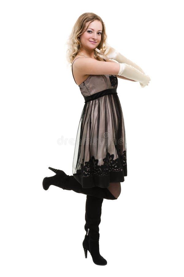Sexy jonge vrouw in een kleine die kleding, op wit wordt geïsoleerd stock afbeeldingen