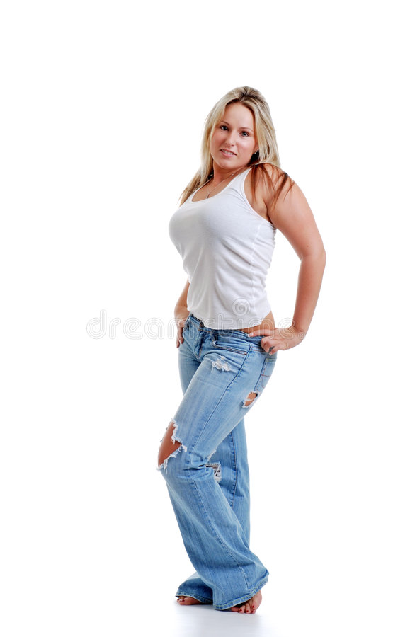 Sexy jonge vrouw met gescheurde jeans stock afbeelding
