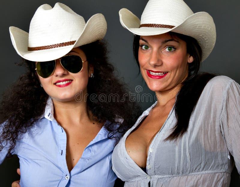 Sexy koejongen met hoed stock fotografie