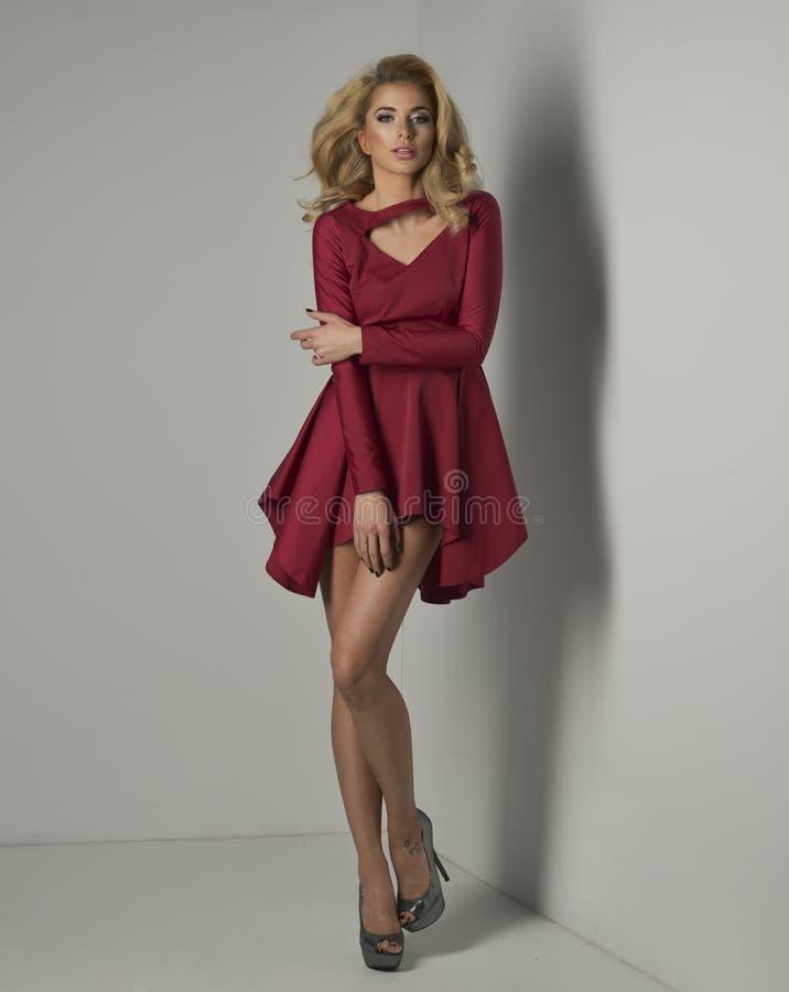 lade wearing red dress stock image