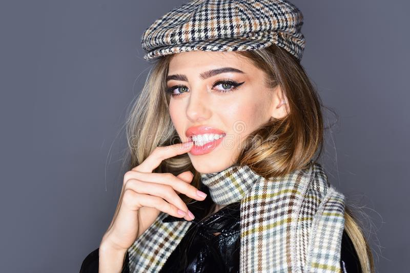 Sexy lady in fashionable outfit, close up. Woman on seductive face with make up with checkered accessories. Fashion royalty free stock image