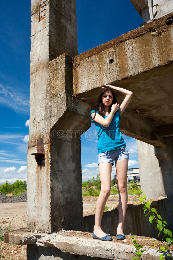 Lady in an industrial background. Portrait of a beautiful young woman in an industrial background stock images